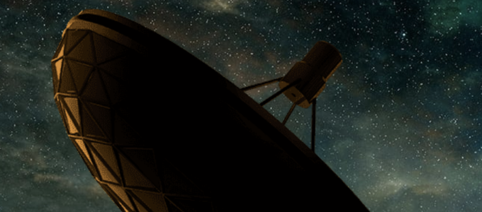 Dish antenna pointing to a starry sky